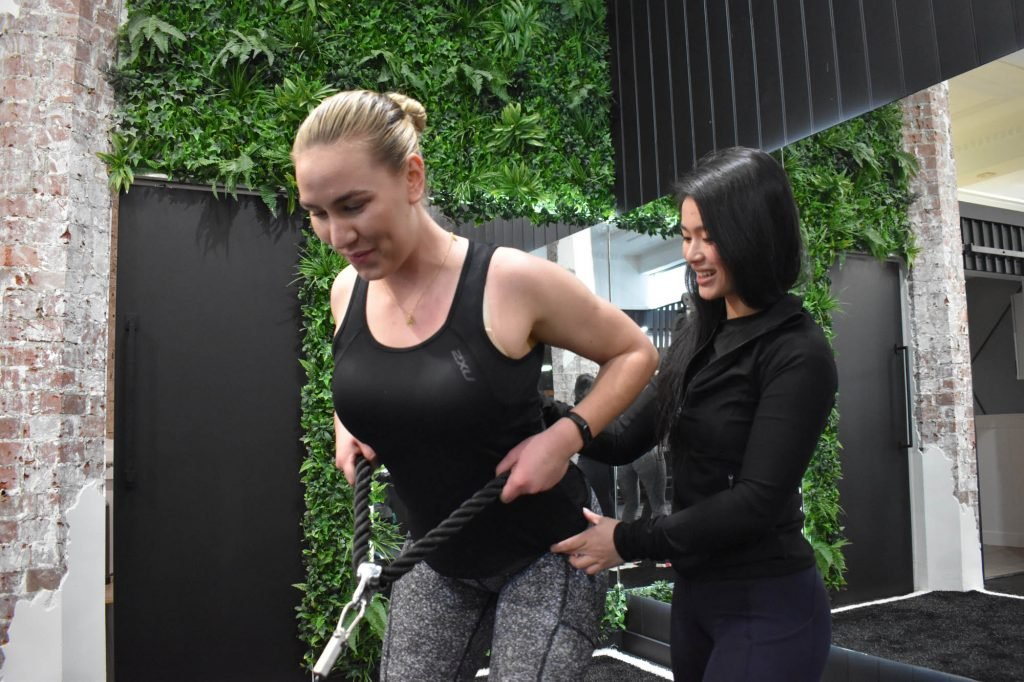 Best Personal Training Kew | Personal Trainer showing client how to use machine for exercise