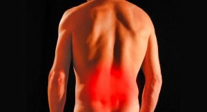Picture of lowerback of person with a red glow demonstrating pain in that area