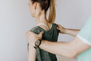 Female with Frozen shoulder being assessed by Physiotherapy