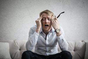 Man with massive vertigo headache causing dizziness